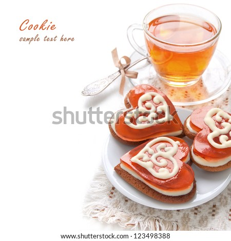 Cookies in the shape of a heart with cherry jelly and white chocolate and morning tea