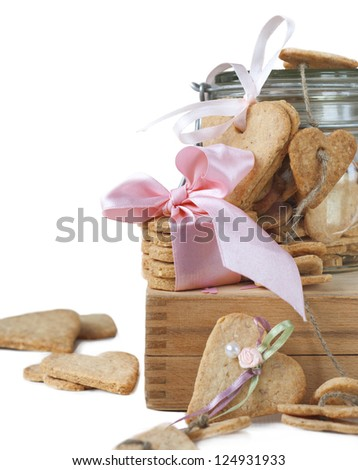 Cookies in the Shape of Heart Decorated with Ribbon at St Valentine's Day Isolated on White