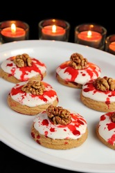 Cookies in white glaze drip blood and walnuts