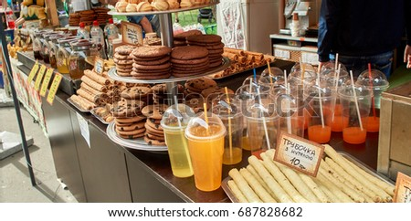 cookies on plates with orange juice #687828682