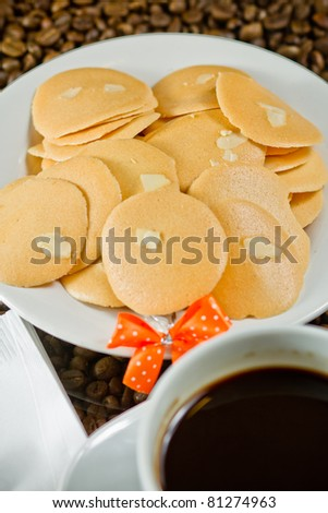 Cookies on the dish with coffee.