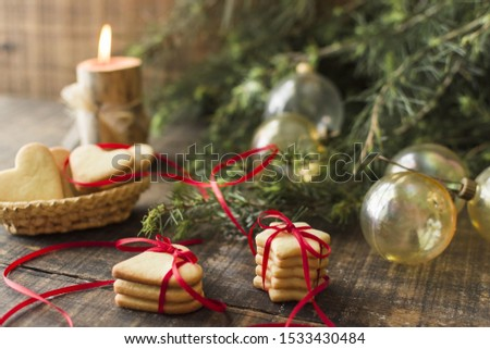 Cookies with baubles on table #1533430484