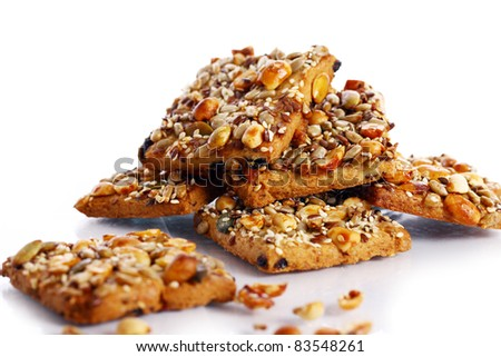 Cookies with different nuts and seeds isolated over white background - stock photo