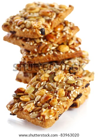 Cookies with different nuts and seeds isolated over white background