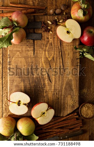 Cooking and baking with apples and cinnamon, cutting board background overhead shot with copy space