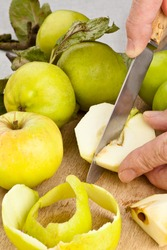 Cooking apples being peeled and cut on a chopping board