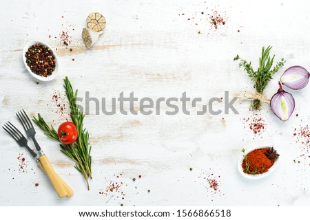 Photo of  Cooking banner. Background with spices and vegetables. Top view. Free space for your text.