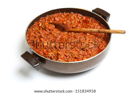 Cooking bolognese sauce in wide saucepan
