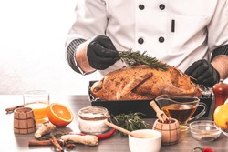 Cooking chef duck sprinkled with rosemary, seasoning, Independence Day of the United States, Day of Grace, Christmas. menu recipe place for text.