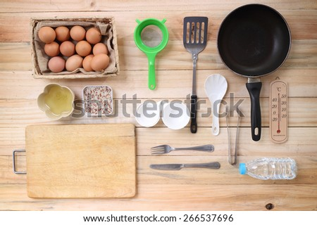Cooking concept. Basic baking ingredients and kitchen set on wood table