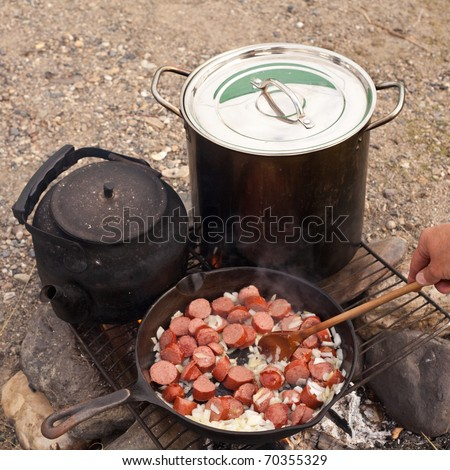 Cooking Dinner on campfire in cast iron pan.