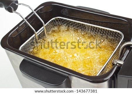Cooking french fries in deep fryer Stockfoto ©