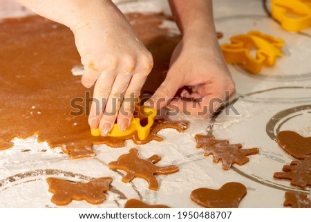 Cooking gingerbread, Women's hands cut out shapes with a pattern for cookies stock photo
