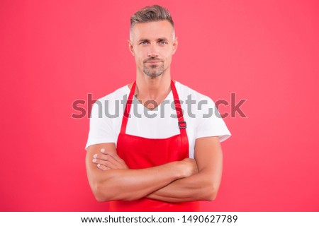 Cooking healthy way. Master of household. Doing household. Home cooking. Grill party. Skilled and confident. Cook wearing bib apron. Bearded mature man in red apron. Mature guy in cooking apron. #1490627789