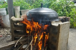 Cooking in a traditional cauldron in Korea.