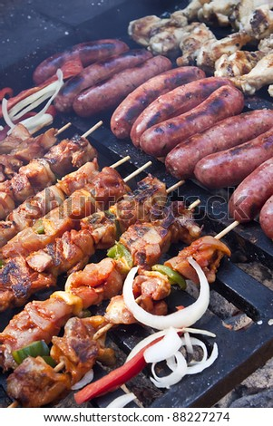 Cooking kebab and sausage on a barbecue grill