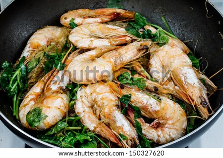 cooking noodle with prawn in a pan - stock photo
