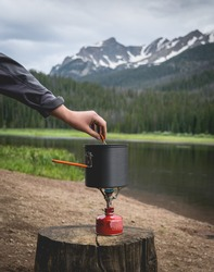 Cooking On A Camping Stove At The Lake