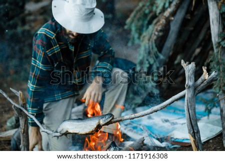 Cooking Over An Open Fire At A Wilderness Campsite #1171916308