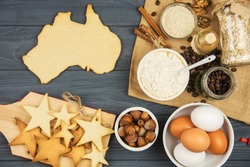 cooking patriotic cookies, gingerbread in shape of Australia. Celebrate Australia Day holiday on January 26