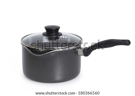 Cooking pot with glass lid on white