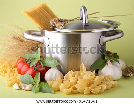 cooking pot with spaghetti and ingredient sauce