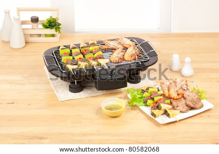 Cooking seafood and barbecue with the barbecue stove in the kitchen