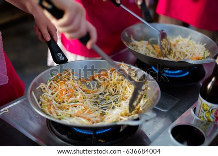 Cooking spring rolls stuffing in wok frying pan. Picture of traditional thai cuisine made of fresh ingredients taken during cooking class in Chiang Mai.