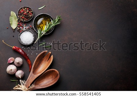 Cooking table with herbs, spices and utensils. Top view with copy space #558541405