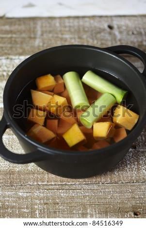 Cooking the diced pumpkin and leeks in boiling water