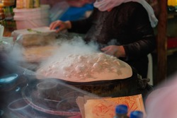 Cooking typical lebanese bread in a bazaar in tel aviv