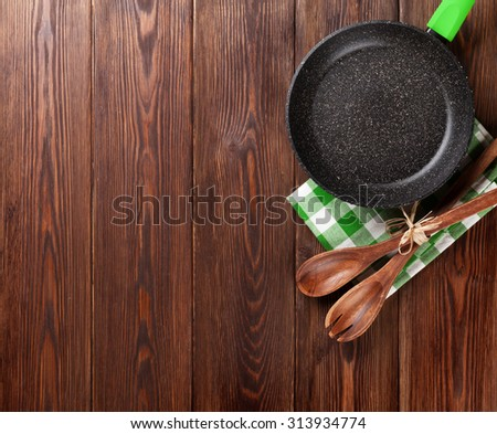 cooking utensil on wooden table....