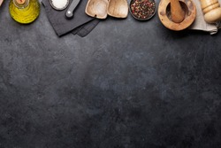 Cooking utensils and spices on stone kitchen table. Top view with copy space for your recipe