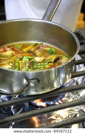 Cooking vegetables on a gas cooker