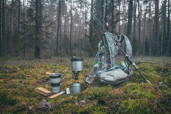 Cooking while hiking with a backpack.
