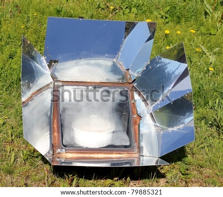 Cooking with the sun in a solar oven on a bright summer day