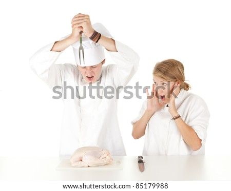cooks team in white uniforms preparing raw chicken, series