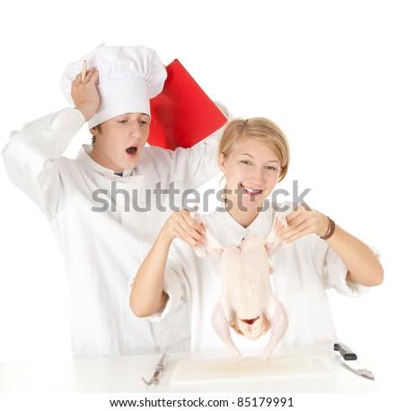 cooks team in white uniforms preparing raw chicken, series