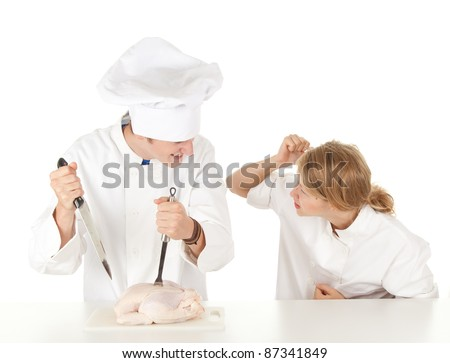 cooks team in white uniforms preparing raw chicken, series - stock photo