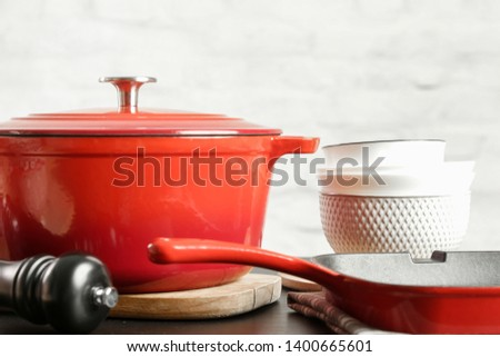 Cookware set: Red enameled cast iron pot, saucepan and bowls #1400665601