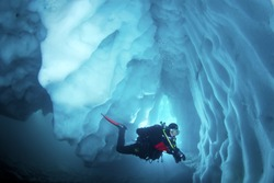 Cool adventure scuba diving in ice cave. Underwater world.