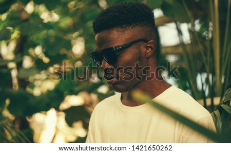 Cool and handsome. Portrait of handsome young African man in sunglasses #1421650262