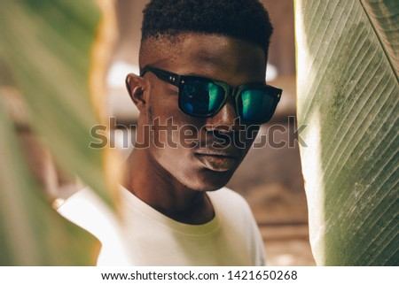 Cool and handsome. Portrait of handsome young African man in sunglasses #1421650268