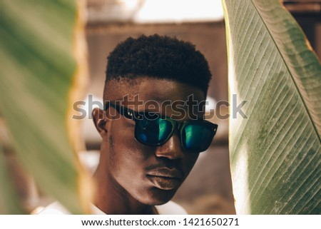 Cool and handsome. Portrait of handsome young African man in sunglasses #1421650271