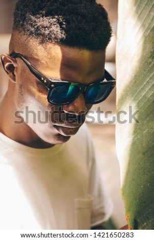 Cool and handsome. Portrait of handsome young African man in sunglasses #1421650283