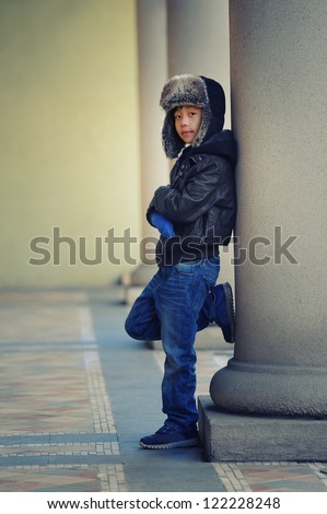 Cool Asian Boy Wearing Winter Hat And Leather Jacket