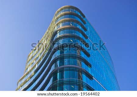 cool blue office building against sky