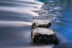 Cool blue stepping stones in a river