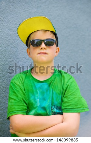cool boy with sunglasses and base-cap