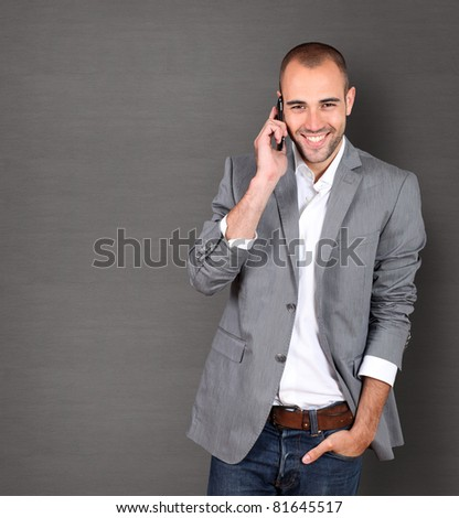 Cool businessman talking on mobile phone